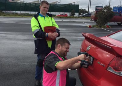 Hoppers Crossing Apex installing anti-theft number plate screws.